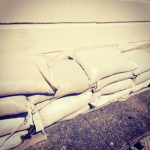 Contaminated sandbags continue to sit outside homes. These have been here since 12-03-14. SFPUC's number one suggestion to help residents: sandbag distribution.